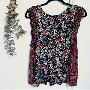 sleeveless flounce blouse with floral patterns